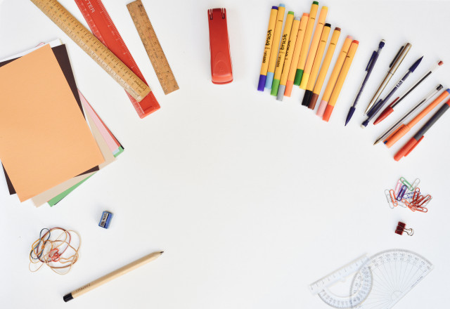 Lost of Creative Stationary On White Desk_